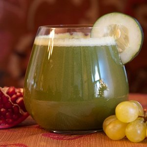 Green juice named Pomegranate Green