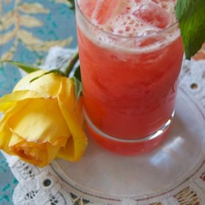 Red juice named Strawberry Mint Julep